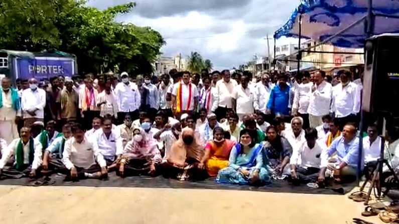 demanding national highway 234 repair localities at manchenahalli sit protest against health minister dr k sudhakar